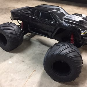 X-maxx With Losi 1/5 scale monster claw tires.
